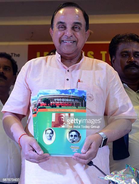 Rajya Sabha members Subramanian Swamy releases a publication at a seminar on 'Emergency' organised by Virat Hindustan Sangam VHS in New Delhi