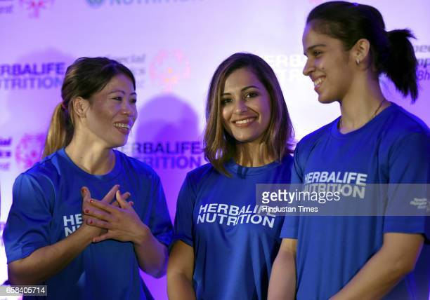 Rajya Sabha MP and Boxer Mary Kom Badminton Player Saina Nehwal Air pistol shooter Heena Sidhu during the felicitation of Indian athletes returning...