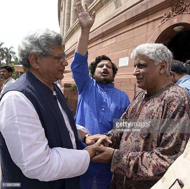 Rajya Sabha MP and CPI General Secretary Sitaram Yechury talking to film personality and Rajya Sabha MP Javed Akhtar after attending the Parliament...