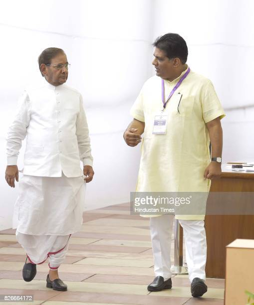 Rajya Sabha MP Bhupender Yadav with JD leader Sharad Yadav after casting votes for Vice Presidential Election at Parliament House on August 5 2017 in...