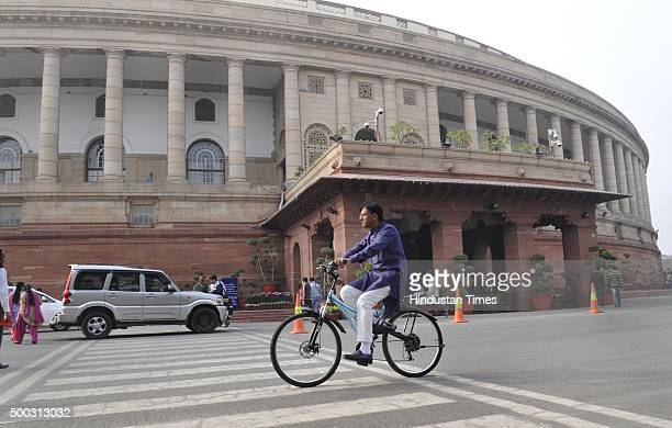 Rajya Sabha MP Mansukh L Mandaviya arrives on his cycle at Parliament during the winter session on December 7 2015 in New Delhi India The third week...