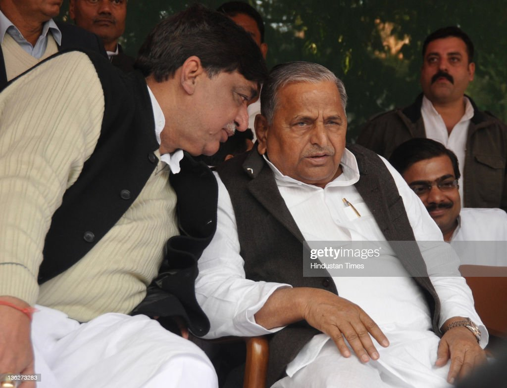 Rajya Sabha MP Naresh Agarwal with Samajwadi Party chief <a gi-track='captionPersonalityLinkClicked' href=/galleries/search?phrase=Mulayam+Singh+Yadav&family=editorial&specificpeople=689640 ng-click='$event.stopPropagation()'>Mulayam Singh Yadav</a> on December 30, 2011 in Lucknow, India. Naresh Aggarwal and his son Nitin Agarwal joined the Samajwadi Party today giving another setback to incumbent Mayawati Government before assembly elections in February, 2012.