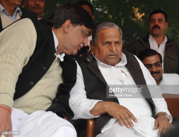 Rajya Sabha MP Naresh Agarwal with Samajwadi Party chief Mulayam Singh Yadav on December 30 2011 in Lucknow India Naresh Aggarwal and his son Nitin...