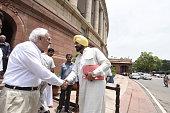 Rajya Sabha MP Navjot Singh Sidhu with Congress Rajya Sabha MP Kapil Sibal during the Parliament Monsoon Session on July 18 2016 in New Delhi India A...