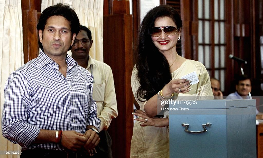 Rajya Sabha MP, Sachin Tendulkar looks on as Rekha casting her vote for the election of Vice President at Parliament house on August 7, 2012 in New Delhi, India. (Photo by Sunil Saxena/Hindustan Times via Getty Images)'