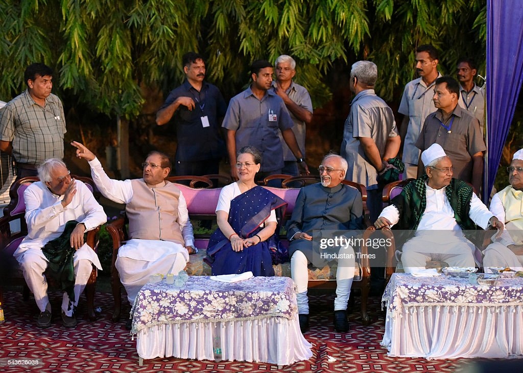 JDU Rajya Sabha MP Sharad Yadav Congress President Sonia Gandhi, Vice President Hamid Ansari with Bihar Chief Minister Nitish Kumar at iftar of JDU party at the residence of former JDU president and Rajya Sabha member Sharad Yadav at 7 Tughlak Road on June 29, 2016 in New Delhi, India.