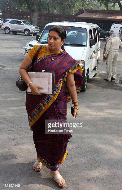 Rajya Sabha MP Smriti Irani arrives for the Parliament winter session at Parliament House on December 7 2011 in New Delhi India During the allparty...