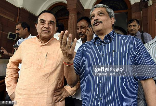 Rajya Sabha MP Subramanian Swamy talking to Union Minister of Defence Manohar Parrikar during the birth anniversary of Dr Syama Prasad Mookerjee at...