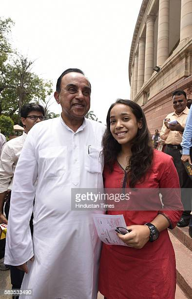 Rajya Sabha MP Subramanian Swamy with his granddaughter Abha after attending the Parliament Monsoon Session on July 26 2016 in New Delhi India The...