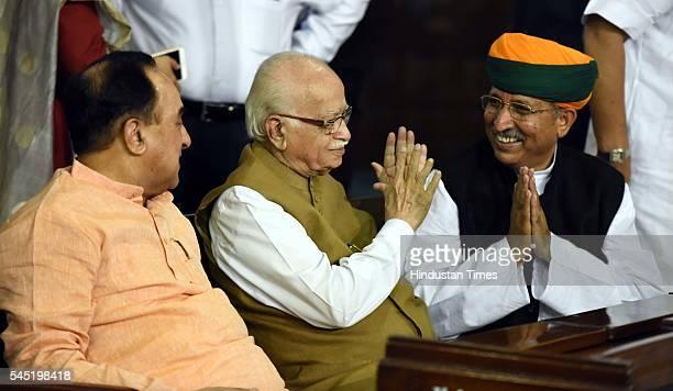 Rajya Sabha MP Subramanian Swamy with Sr BJP leader and Lok Sabha MP Lal Krishna Advani and new Minister of State Finance Arjun Ram Meghwal during...