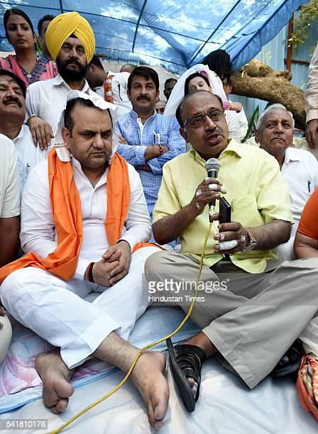 Rajya Sabha MP Vijay Goel joins Bharatiya Janata Party MP Mahiesh Girri during his indefinite fast outside the residence of Delhi Chief Minister...