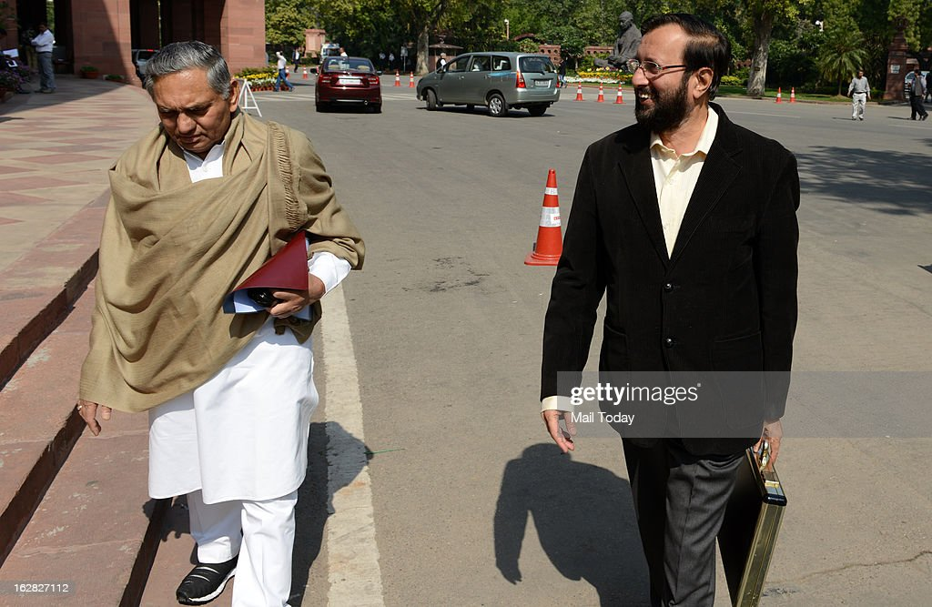 Rajya Sabha MPs Janardan Dwivedi and Prakash Javadekar during the ongoing budget session at Parliament House on Wednesday.