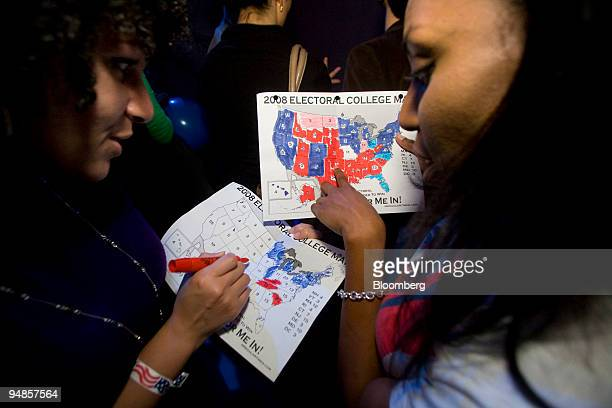 Rakeda Leaks right and Candice Williams fill out electoral college maps at The Democratic Leadership for the 21st Century's election night bash at...