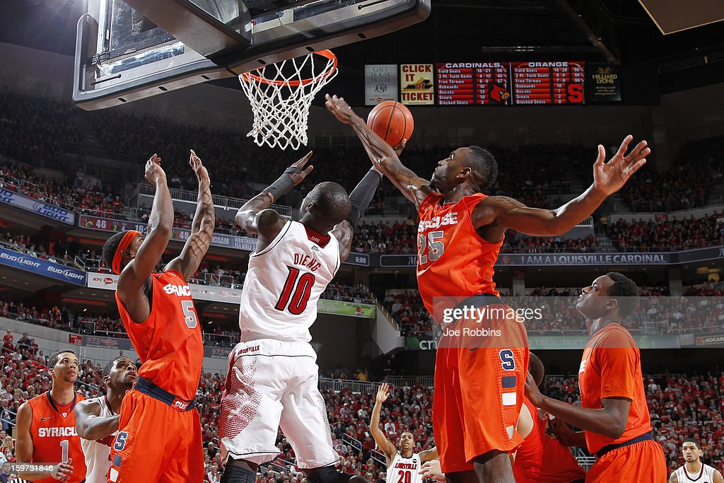 Rakeem Christmas #25 and C.J. Fair #5 of the Syracuse Orange defend against Gorgui Dieng #10 of the Louisville Cardinals during the game at KFC Yum! Center on January 19, 2013 in Louisville, Kentucky. Syracuse defeated Louisville 70-68.