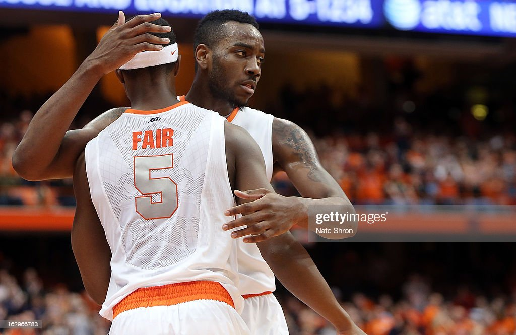 Rakeem Christmas #25 and <a gi-track='captionPersonalityLinkClicked' href=/galleries/search?phrase=C.J.+Fair&family=editorial&specificpeople=7366451 ng-click='$event.stopPropagation()'>C.J. Fair</a> #5 of the Syracuse Orange embrace on the court during the game against the Louisville Cardinals at the Carrier Dome on March 2, 2013 in Syracuse, New York.