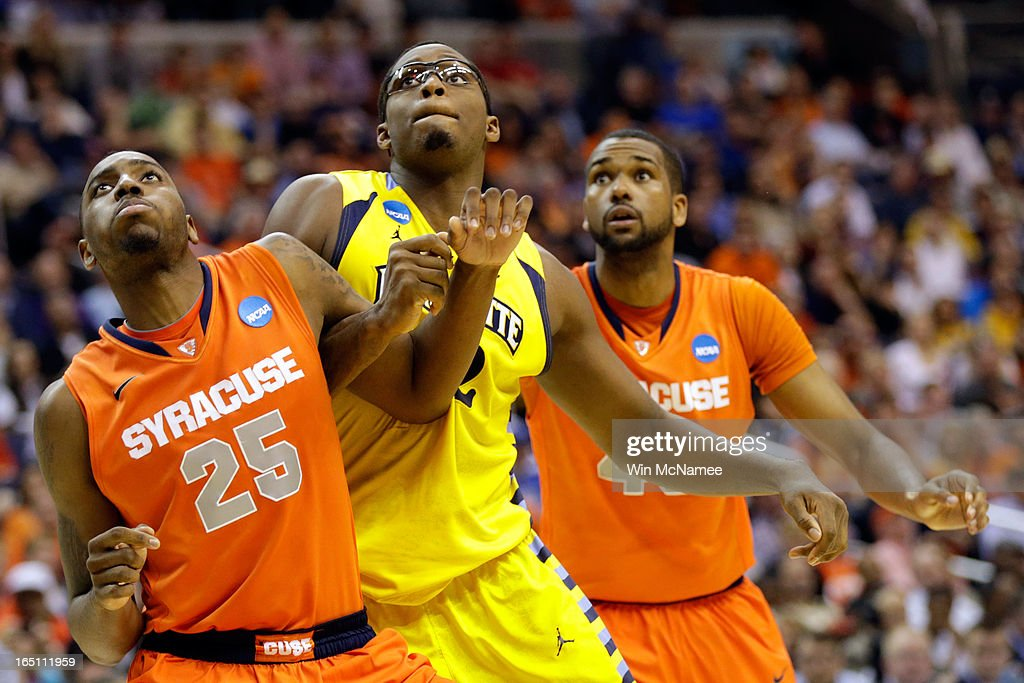 Rakeem Christmas #25 and James Southerland #43 of the Syracuse Orange fights for position against <a gi-track='captionPersonalityLinkClicked' href=/galleries/search?phrase=Chris+Otule&family=editorial&specificpeople=5678342 ng-click='$event.stopPropagation()'>Chris Otule</a> #42 of the Marquette Golden Eagles during the East Regional Round Final of the 2013 NCAA Men's Basketball Tournament at Verizon Center on March 30, 2013 in Washington, DC.
