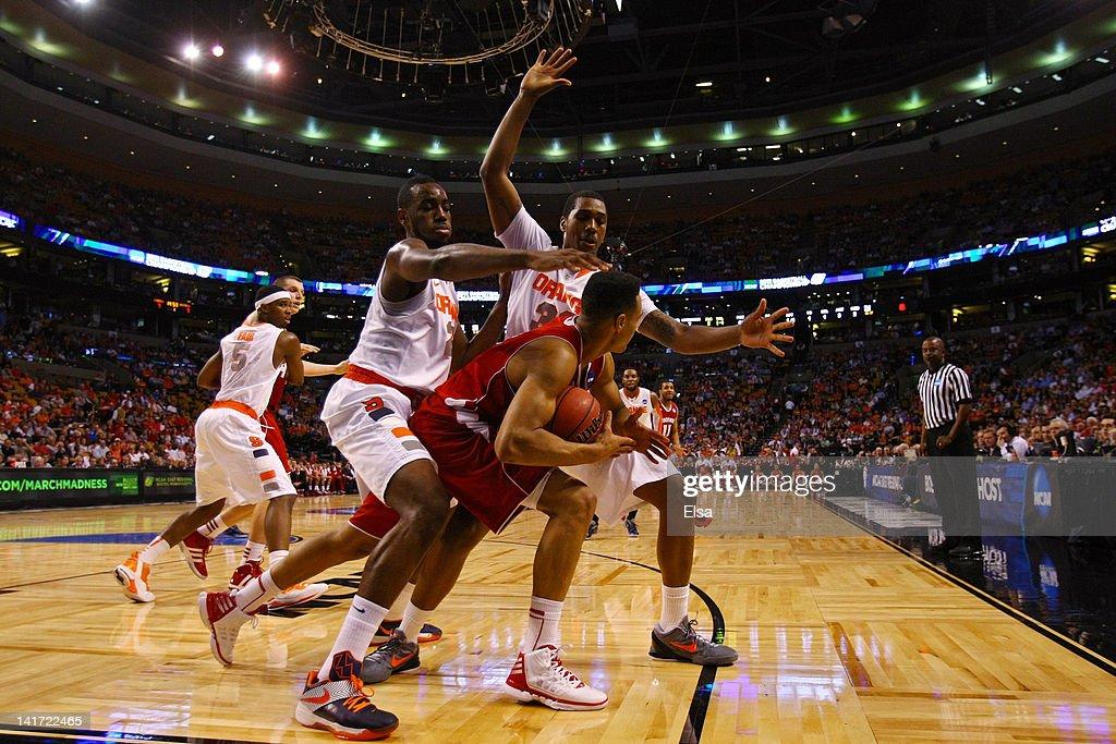 Rakeem Christmas and Kris Joseph of the Syracuse Orange defend against Ryan Evans of the Wisconsin Badgers during their 2012 NCAA Men's Basketball...