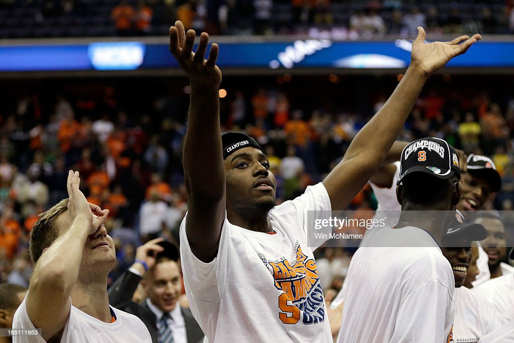Rakeem Christmas #25 of the Syracuse Orange celebrates after defeating the Marquette Golden Eagles to win the East Regional Round Final of the 2013 NCAA Men's Basketball Tournament at Verizon Center on March 30, 2013 in Washington, DC.