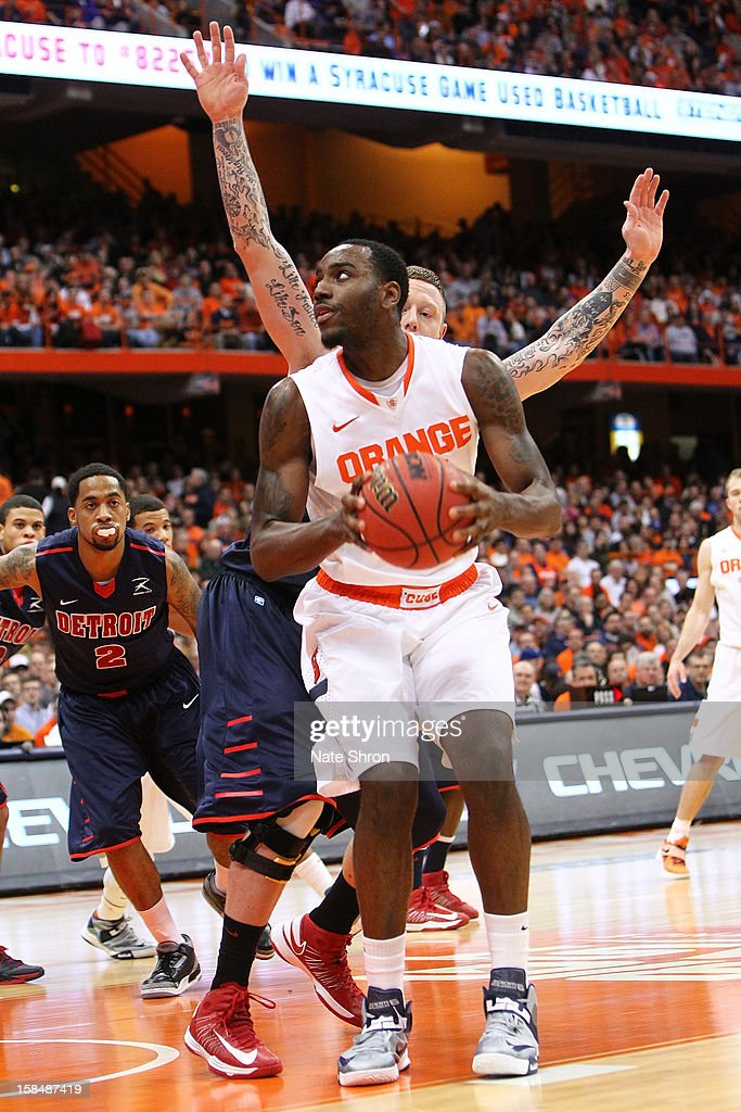 Rakeem Christmas #25 of the Syracuse Orange drives to the basket against Nick Minnerath #34 of the Detroit Titans during the game at the Carrier Dome on December 17, 2012 in Syracuse, New York.
