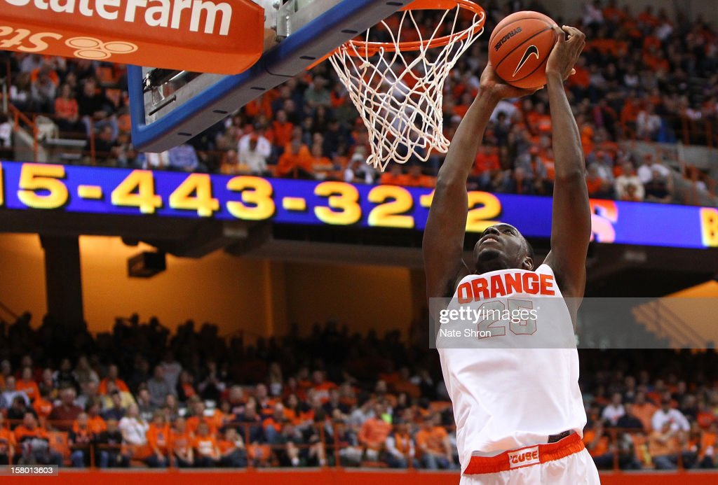 Rakeem Christmas #25 of the Syracuse Orange dunks the ball during the game against the Monmouth Hawks at the Carrier Dome on December 8, 2012 in Syracuse, New York.