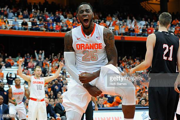 Rakeem Christmas of the Syracuse Orange reacts to a dunk against the Carleton Ravens during the second half at the Carrier Dome on November 2 2014 in...