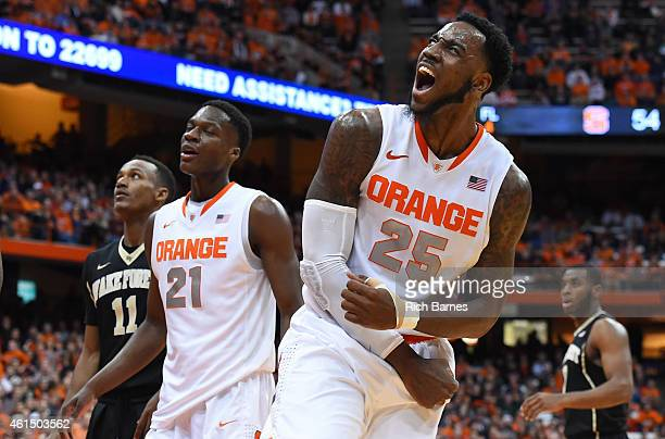 Rakeem Christmas of the Syracuse Orange reacts to a made basket and a foul against the Wake Forest Demon Deacons during the second half at the...