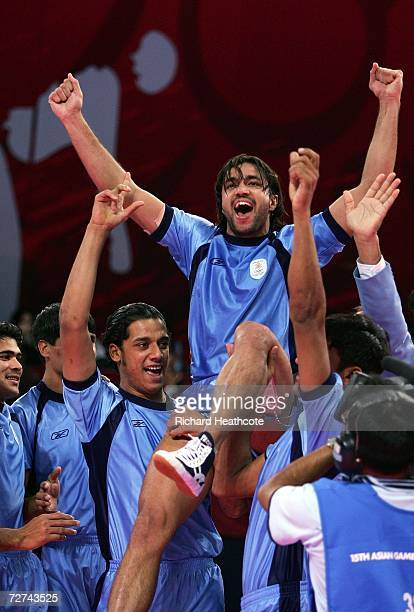 Rakesh Kumar of India celebrates with his team mates after winning the gold medal by defeating Pakistan in the Men's Kabaddi Gold Medal match at the...