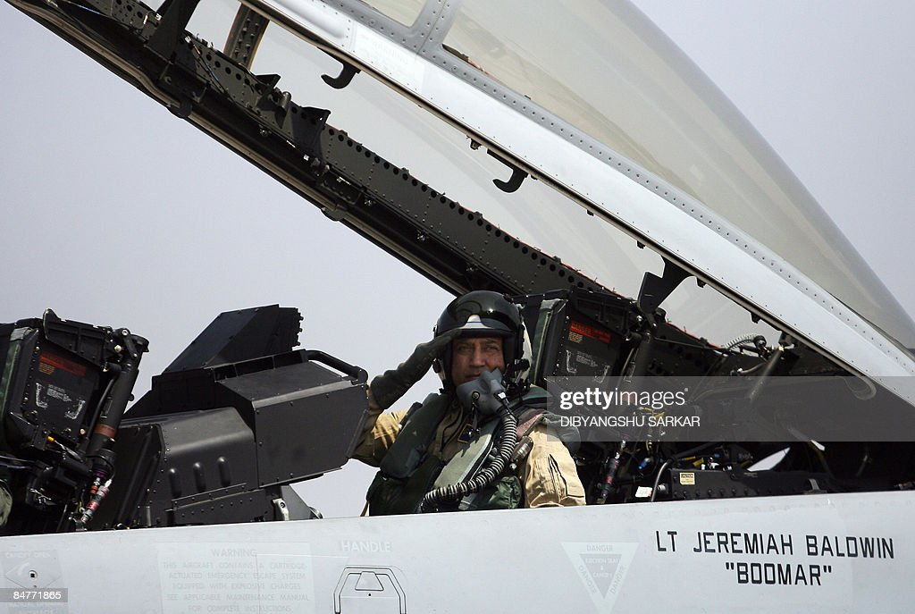 Rakesh Sharma, India's first astronaut who went into space in 1984, salutes before a flight on board an F/A-18F Super Hornet at the Yelahanka Air Force Station during the third day of Aero India 2009 in Bangalore February 13, 2009. South Asia's biggest airshow opened on February 11 with firms from 25 countries showcasing their latest hardware in a chase for multibillion-dollar contracts with the Indian military. AFP PHOTO/Dibyangshu SARKAR