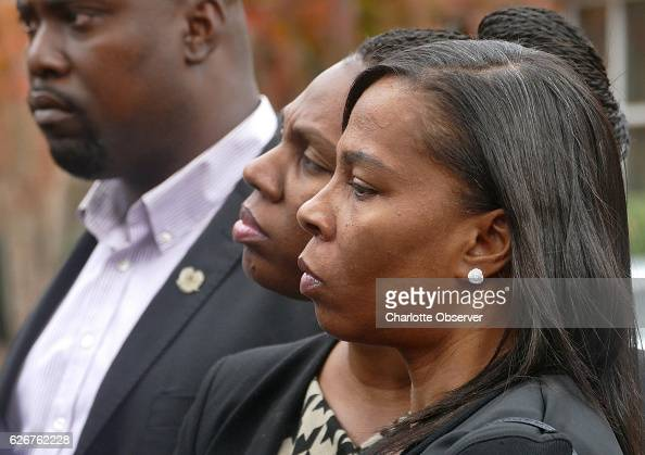 Rakeyia Scott right widow of Keith Lamont Scott stands with her sister Rachel Dotch and brotherinlaw Cory Dotch during a press conference after the...