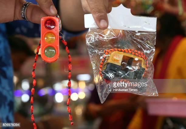 Rakhi designed as auto and traffic signals at a shop on the eve of Raksha Bandhan Festival on August 6 2017 in Jaipur India Raksha Bandhan or simply...