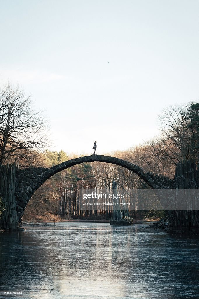 Rakotz Bridge Over River Against Sky At Forest