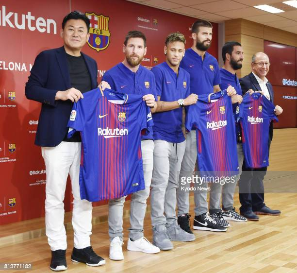 Rakuten Inc CEO Hiroshi Mikitani with FC Barcelona players Lionel Messi Neymar Gerard Pique and Arda Turan show off the team's shirt for the 20172018...