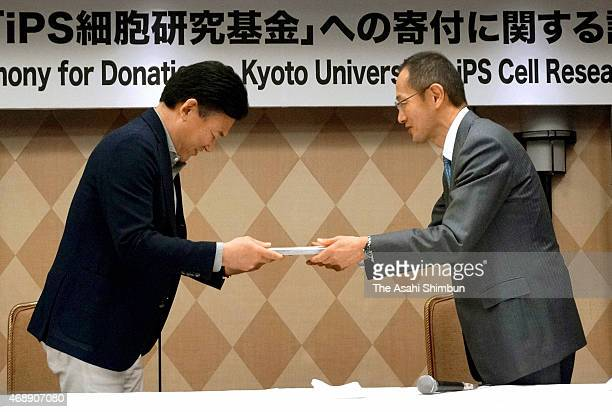 Rakuten Inc Chairman and CEO Hiroshi Mikitani receives the letter of appreciation by Kyoto University Center for iPS Cell Research and Application...
