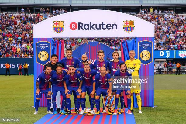 Rakuten President and CEO Hiroshi Mikitani poses with the Barcelona starting eleven prior to the first half of the International Champions Cup soccer...