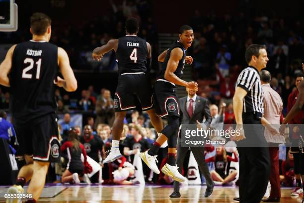 Rakym Felder and PJ Dozier of the South Carolina Gamecocks react in the second half against the Duke Blue Devils during the second round of the 2017...
