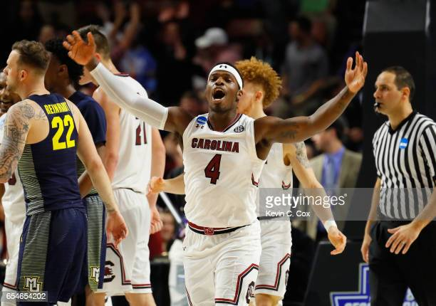 Rakym Felder of the South Carolina Gamecocks celebrates their 9373 win over the Marquette Golden Eagles during the first round of the 2017 NCAA Men's...