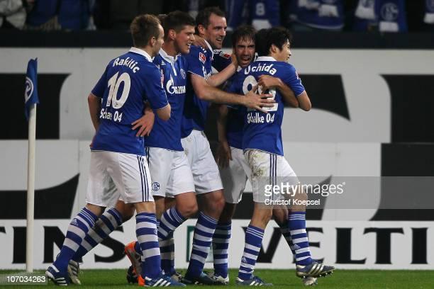 Raúl Gonzalez of Schalke celebrates his third goal with Atsuto Uchida of Schalke Ivan Rakitic KlaasJan Huntelaar of Schalke and Christoph Metzelder...