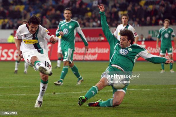 Raúl Marcelo Bobadilla of Moenchengladbach scores his second and the decision goal against Andrea Barzagli of Wolfsburg during the Wintercup match...