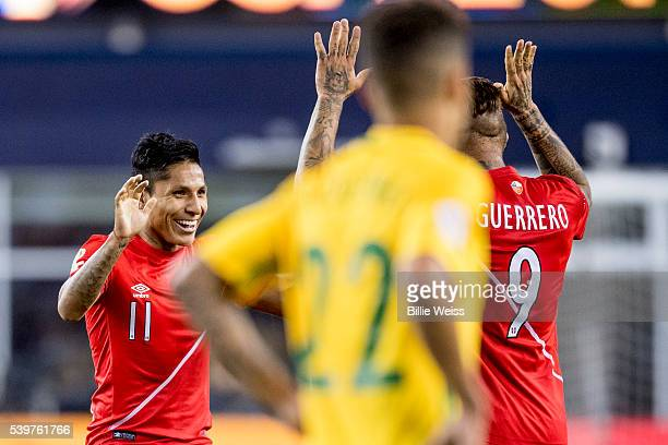 Raúl Ruidíaz of Peru celebrates with teammate Paolo Guerrero after winning a group B match between Brazil and Peru at Gillette Stadium as part of...