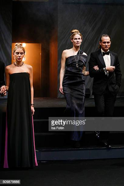 Ralf Bauer and a model walk the runway at the Inhorgenta Opening Show Party on February 12 2016 in Munich Germany