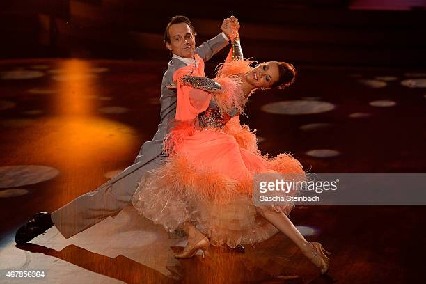 Ralf Bauer and Oana Nechiti perform on stage during the 3rd show of the television competition 'Let's Dance' on March 27 2015 in Cologne Germany