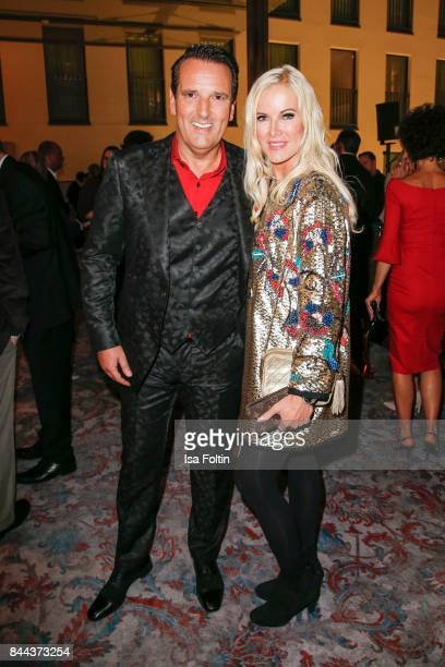 Ralf Duemmel jury member of 'Hoehle der Loewen' and his partner German presenter Anna Heesch attend a QVC event during the Vogue Fashion's Night Out...