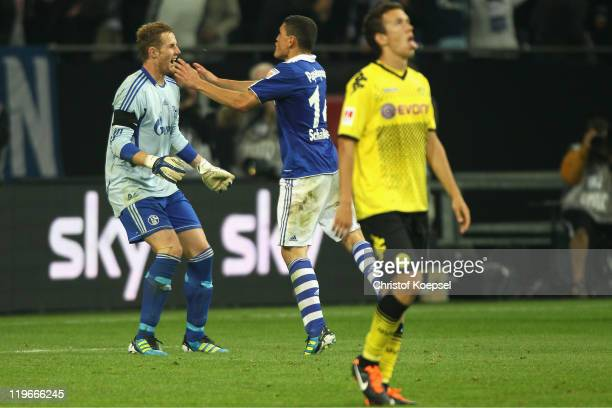Ralf Faehrmann and Kyriakos Papadopoulos of Schalke celebrate winning 43 after penalty shootout the Supercup match between FC Schalke 04 and Borussia...