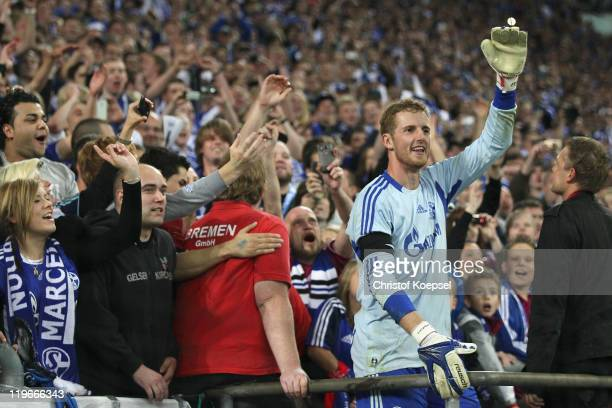 Ralf Faehrmann celebrates with the fans after winning the Supercup match between FC Schalke 04 and Borussia Dortmund at Veltins Arena on July 23 2011...