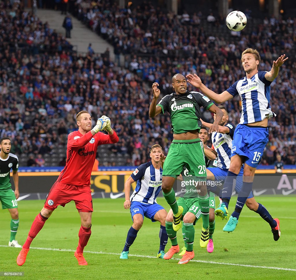 Ralf Faehrmann of FC Schalke 04, Naldo of FC Schalke 04 and Sebastian Langkamp of Hertha BSC during the game between Hertha BSC and FC Schalke 04 on September 18, 2016 in Berlin, Germany.