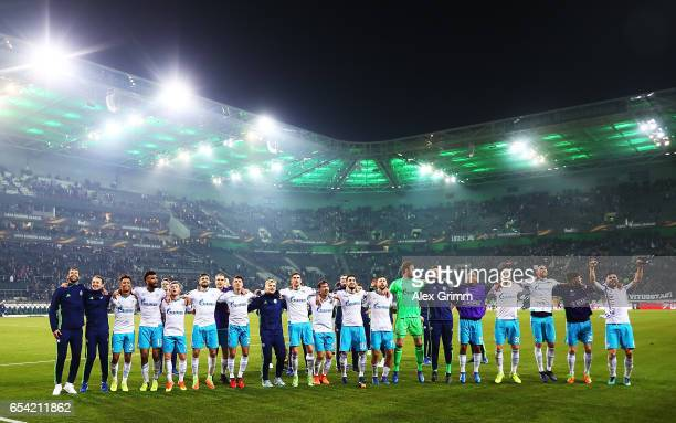 Ralf Faehrmann of Schalke 04 celebrates with team mates after the UEFA Europa League Round of 16 second leg match between Borussia Moenchengladbach...
