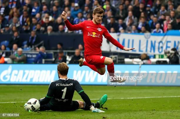 Ralf Faehrmann of Schalke challenges Timo Werner of Leipzig during the Bundesliga match between FC Schalke 04 and RB Leipzig at VeltinsArena on April...