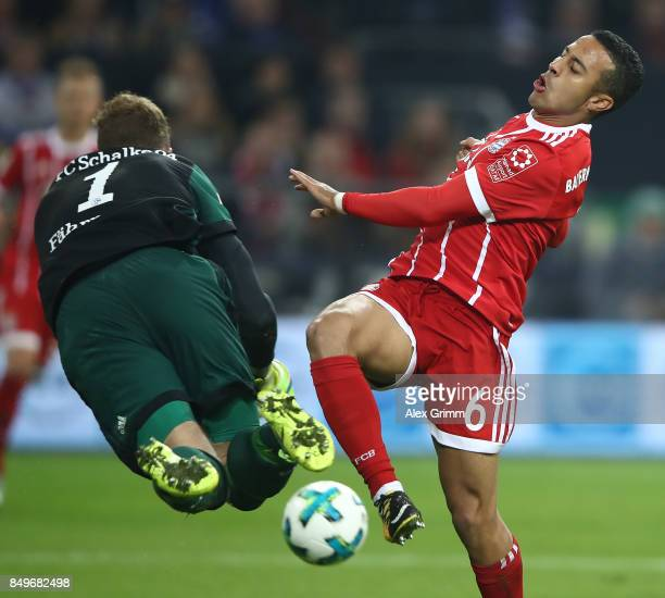Ralf Faehrmann of Schalke fights for the ball with Thiago Alcantara of Bayern Muenchen during the Bundesliga match between FC Schalke 04 and FC...