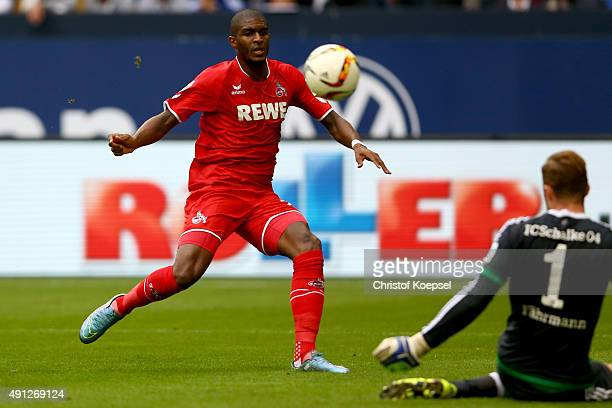 Ralf Faehrmann of Schalke saves a ball against Anthony Modeste of Koeln during the Bundesliga match between FC Schalke 04 and 1 FC Koeln at...