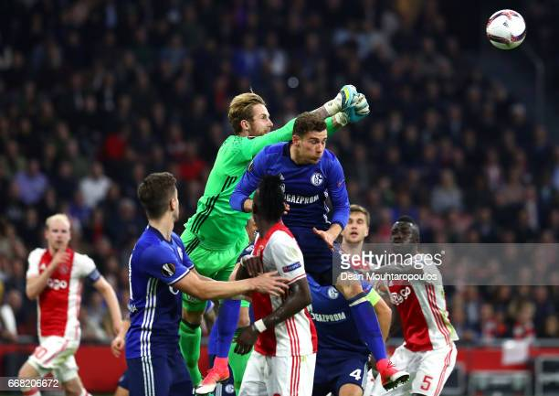 Ralf Fahrmann of FC Schalke 04 clears the ball from the corner during the UEFA Europa League quarter final first leg match between Ajax Amsterdam and...
